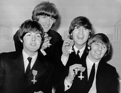 Paul, George, John and Ringo hold up their MBE awards at a news conference following their investiture on October 26, 1965 at Buckingham Palace in London . AFP / UPI PHOTO (Photo credit PETER SKINGLEY/ AFP/Getty Images)